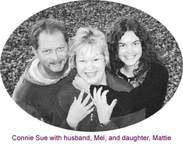 Connie Sue with husband, Mel, and daughter, Mattie in 2004
